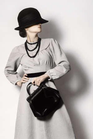 handbag: Fashion model in vintage dress Elegant woman Retro clothes style