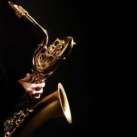 Saxophone player Jazz Music Instrument Baritone Sax isolated on black