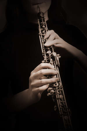 oboe: Oboe hands musical instruments isolated on black Oboist closeup Stock Photo