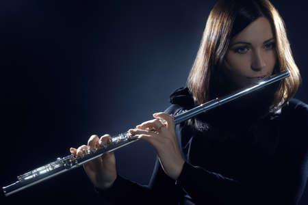 flute: Flute player flutist classical musician playing flute instrument