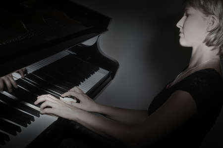 piano player: Grand Piano player. Pianist playing piano concert classical musical instruments