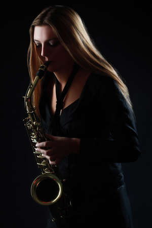 saxophonist: Saxophone Player Saxophonist woman playing Sax alto musician with instrument