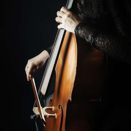 symphony orchestra: Cello player cellist playing music instrument hands closeup. Orchestra instruments