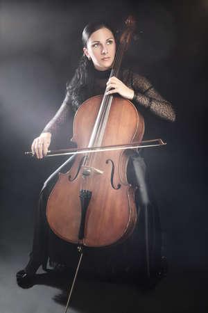 cellist: Cello player cellist playing violoncello Classical musicians Stock Photo