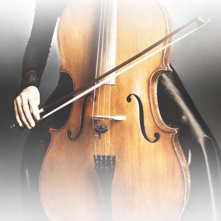 violoncello: Cello closeup with bow Cello player cellist playing violoncello Stock Photo