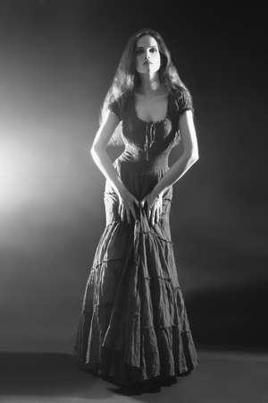 maxi dress: Elegant woman in long dress. Fashion model in evening dress Stock Photo