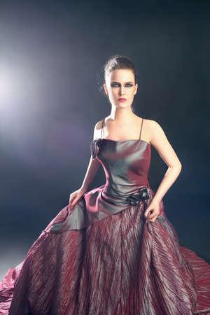 fine art portrait: Elegant woman in evening dress. Fashion model in long dress