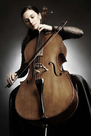 Cello player cellist playing violoncello Фото со стока