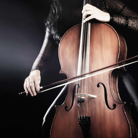 cellist: Cello player playing violoncello. Cellist with musical instruments Stock Photo