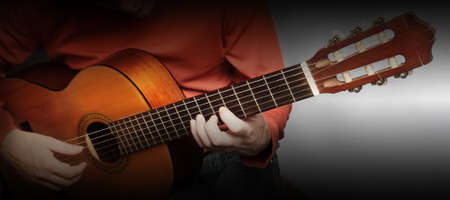 Guitarist hands Guitar player Closeup musical instruments