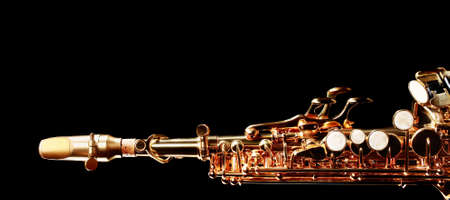 soprano saxophone: Saxophone soprano jazz music instruments isolated on black Sax close up Foto de archivo