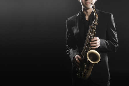 young musician: Saxophone payer Saxophonist jazz man playing sax alto