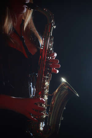 payer: Saxophone payer Saxophonist playing sax alto hands closeup Stock Photo