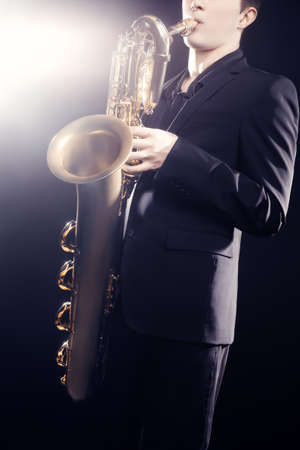 payer: Saxophone payer Saxophonist playing Jazz music baritone sax Stock Photo