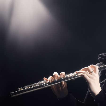 professional flute: Flute instrument. Classical music flute player hands closeup Stock Photo