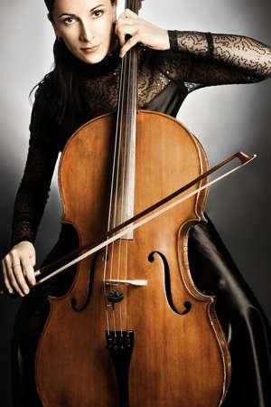 violoncello: Cello player. Cellist woman musician playing violoncello