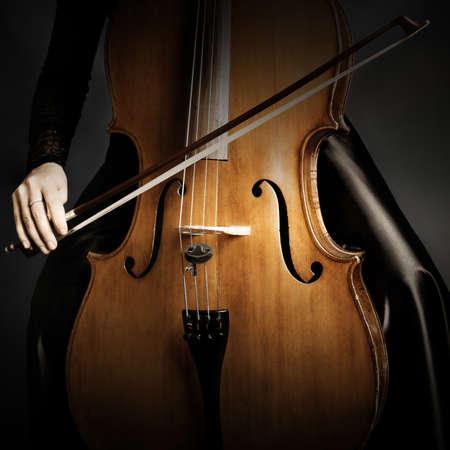 Cello Orchestra musical instruments. Cellist hands closeup