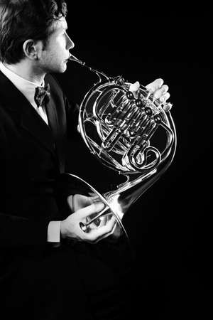 french horn: French horn player Classical musicians playing musical instruments