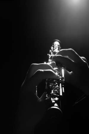 Oboe player hands playing Woodwinds Musical instruments oboist