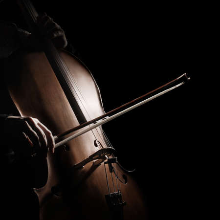 Cello player cellist playing violoncello. Musical instruments closeup isolated