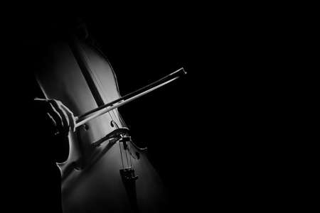 cellos: Cello player cellist playing violoncello. Musical instruments of orchestra closeup isolated