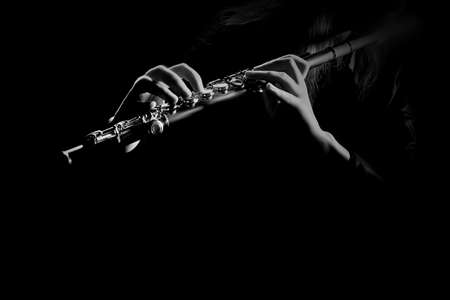 Flute instrument isolated on black flutist hands playing flute music Banco de Imagens