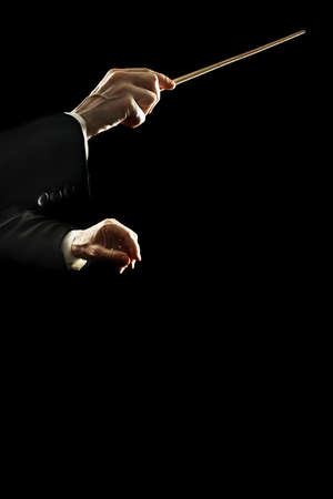 Orchestra conductor music conducting hands with baton stick close up isolated