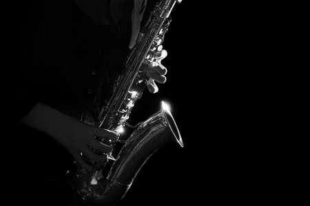 Saxophone Jazz musical instruments Saxophonist playing sax player Foto de archivo