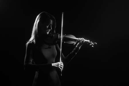 photography: Violin player Violinist playing violin concert Classical musicians