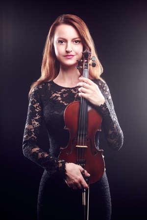 violin player: Beautiful portrait of woman violin player Classical musician Stock Photo