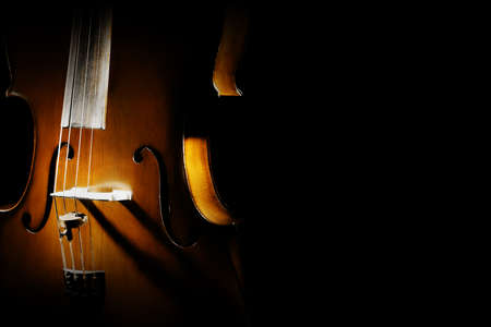 cellos: Cello close up orchestra musical instruments isolated on black background