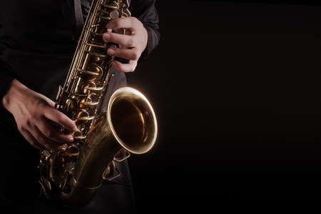 Saxophone player Saxophonist playing Jazz music instruments close up musicians hands Foto de archivo