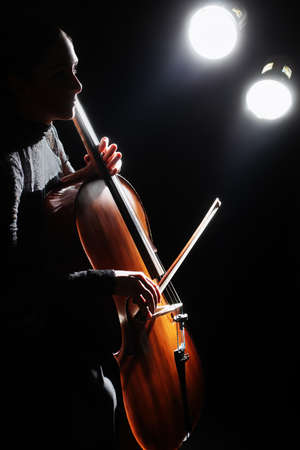 Cello player cellist playing violoncello concert. Classical musicians with musical instruments