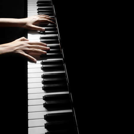 piano player: Piano player pianist hands playing grand piano Musical instruments close up