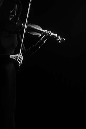 Violin player violinist hands playing musical instruments isolated on black