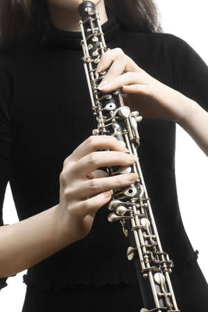 oboe: Oboe player hands Woodwind musical instruments close up detail oboist