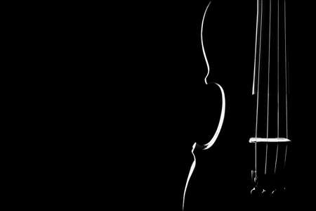 Violin closeup silhouette isolated on black Orchestra musical instruments close up Stock Photo