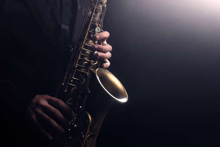 Saxophone player Saxophonist playing jazz music instrument sax alto Jazz musician hands closeup