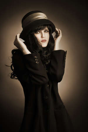 Brunette woman in black hat and dress Portrait of young romantic woman photo