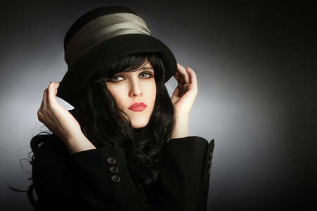 Young romantic woman portrait in black hat Brunette with black hair photo