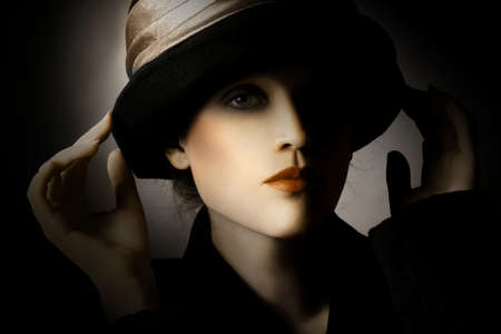 Retro woman in hat vintage portrait. Elegant lady in hat fashion style photo