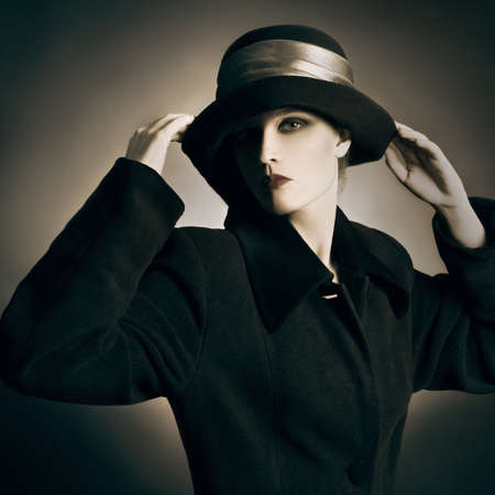 Retro woman in vintage hat and coat Elegant woman in black photo