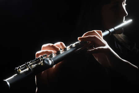 Flute instrument Flutist hands playing flute music. Classical orchestra instruments