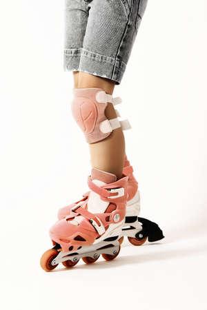 rollerskater: Roller skating. Roller skater legs in rollerblade isolated on white. Rollerblader