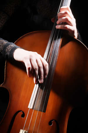 Cello player cellist hands playing violoncello pizzicato music Classical musical instruments detail.