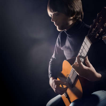 Acoustic guitar player Guitarist playing classical guitar. Man with musical instrument 版權商用圖片