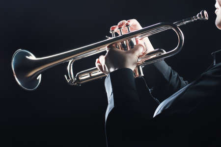 Trumpet player. Trumpeter hands playing wind musical instrument