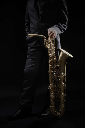 Saxophone player jazz musician. Saxophonist with baritone sax player Stock Photo