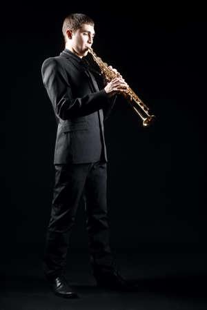 soprano saxophone: Jugador de saxofón Músico de jazz. Soprano sax player blues music. Saxofonista