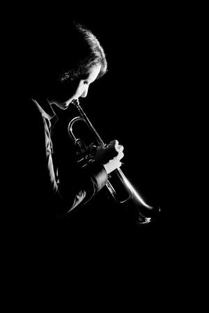 Trumpet player. Trumpeter playing jazz musical instrument Stock Photo